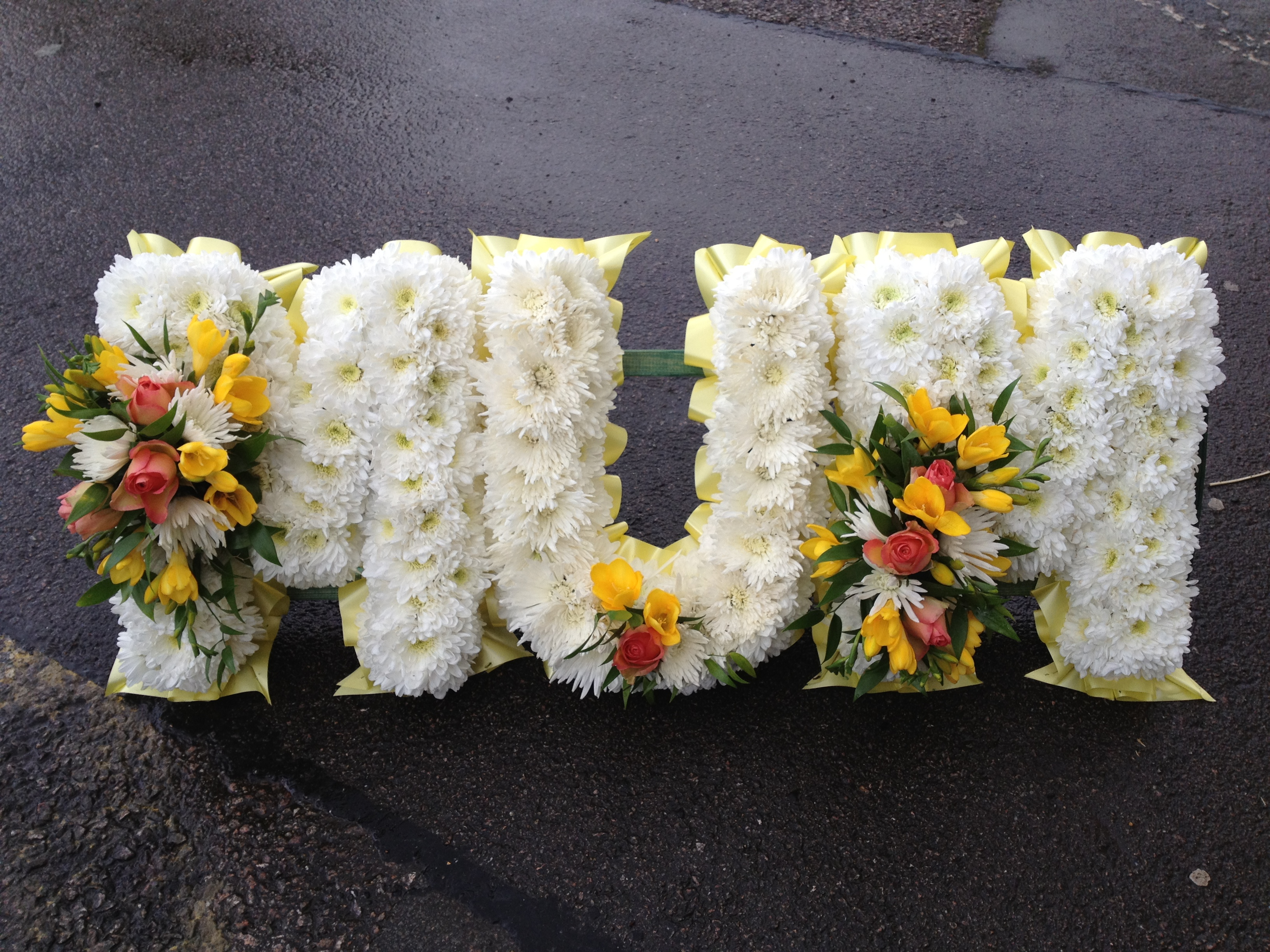 Block letter funeral flowers flowers by elja call now 0116 mum tribute 7500 izmirmasajfo Image collections
